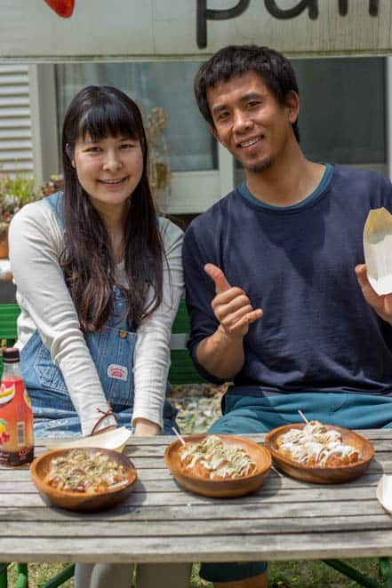 Masa-san and his wife with the many many Takoyaki ready for eating.