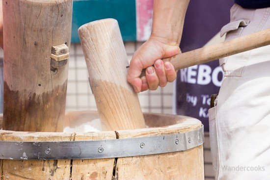 Organic mochi making and recipe - pressing the rice together in preparation to be pounded.