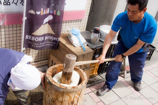 Sticky rice being pounded into mochi in Japan.