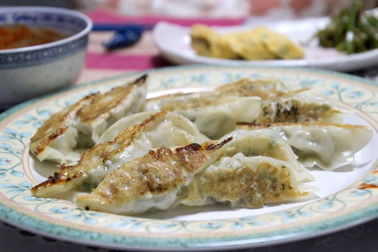 Pork Gyoza Recipe - crispy on bottom and ready to dip in the homemade spicy soy sauce.