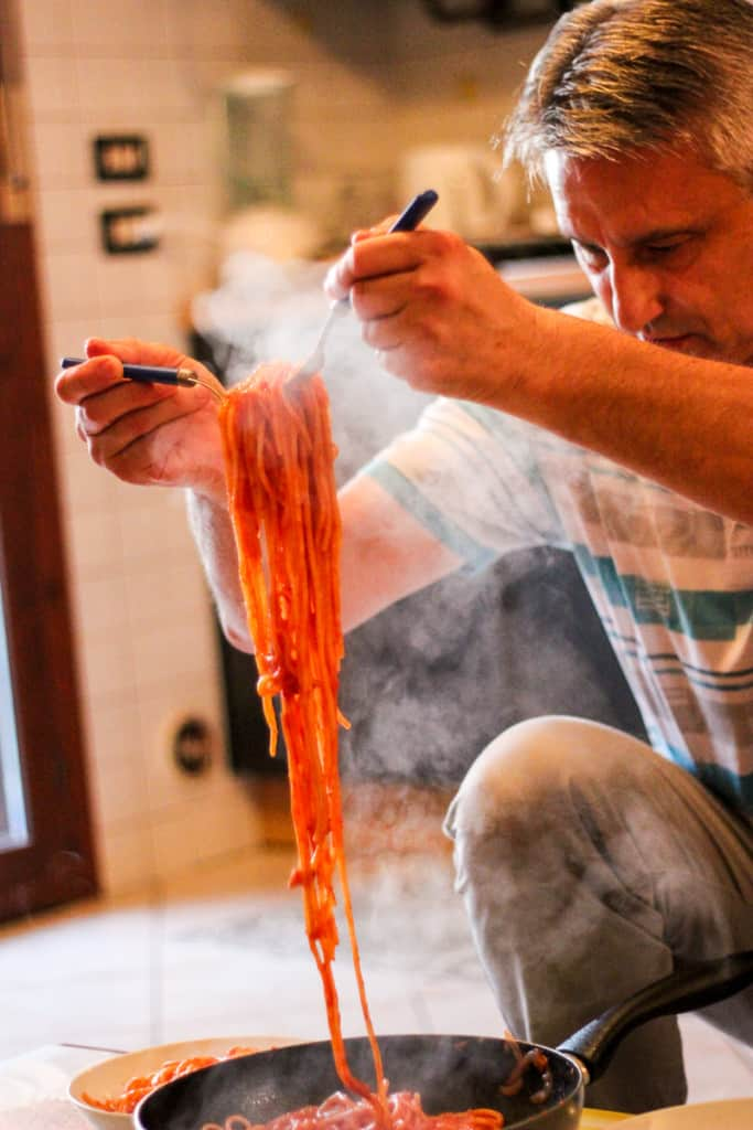 Amatraciana Recipe - Stefano steams up the living room as he plates up.