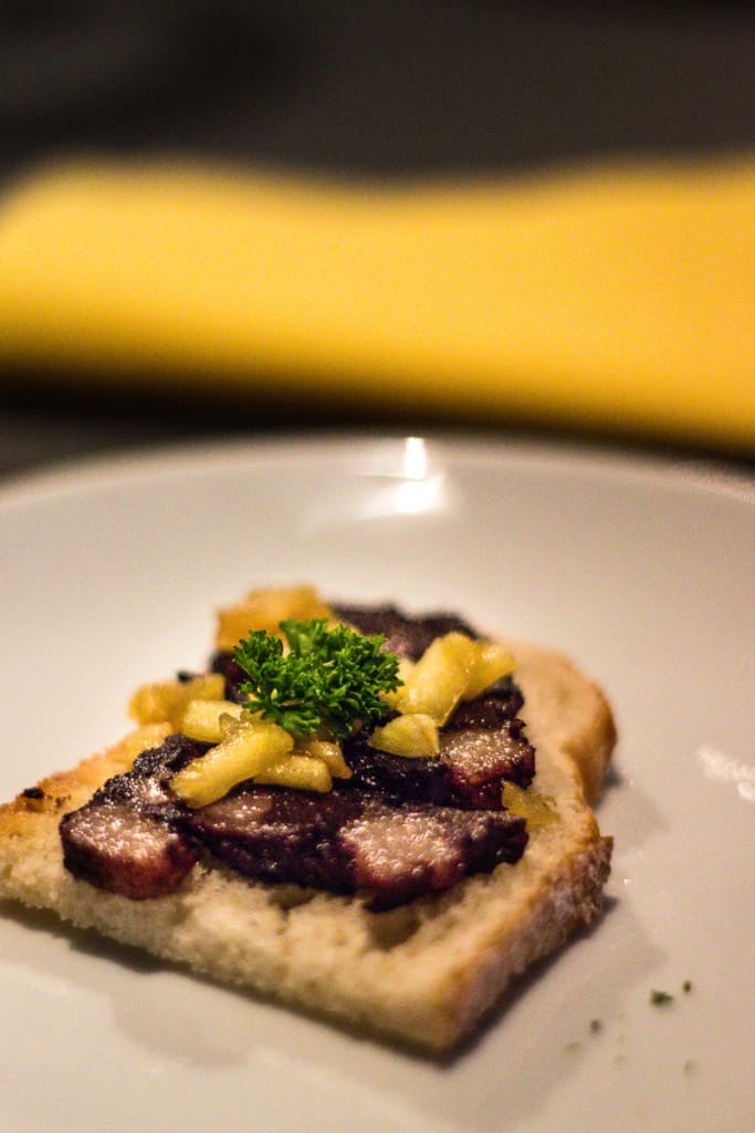 Black Pudding Brioche - Fried black pudding topped with sauteed apples and parsley on small brioche.