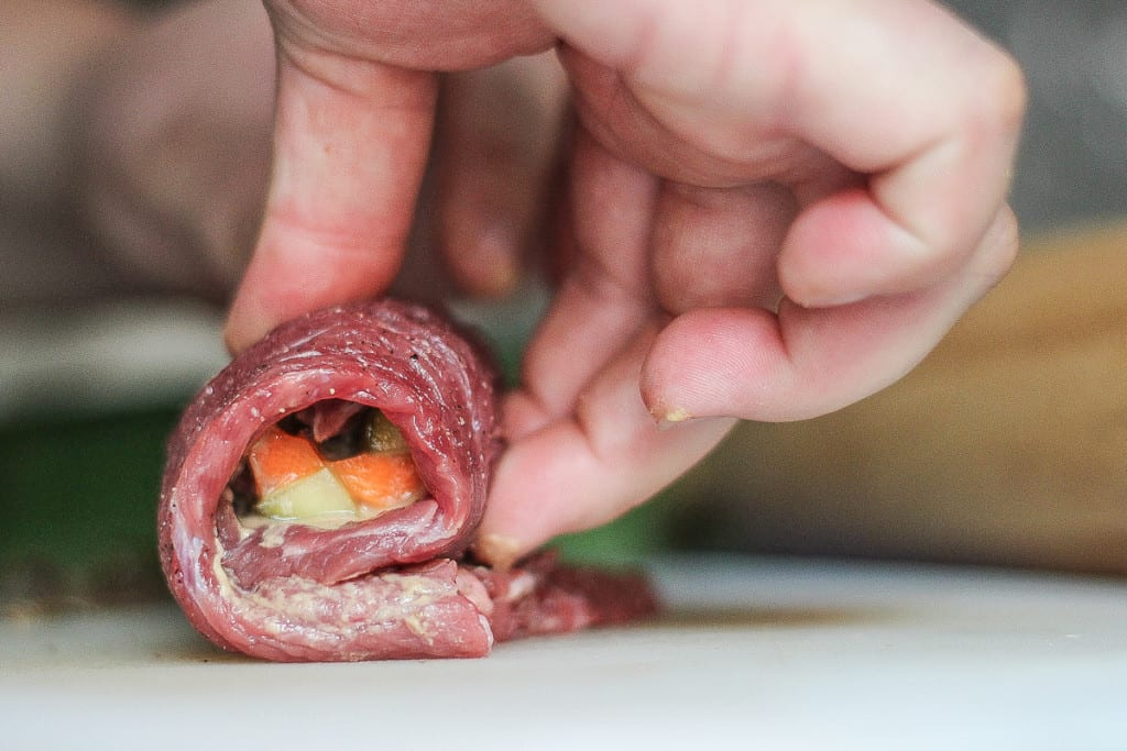 Viennese Beef Roulade - Delicately wrap the meat tightly, ready to pin with a few toothpicks.