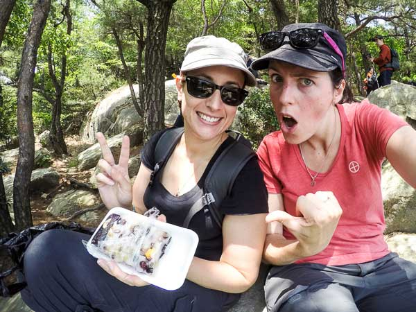 10 Months Eating on the Road - Eating our street food while hiking in Busan, Korea.