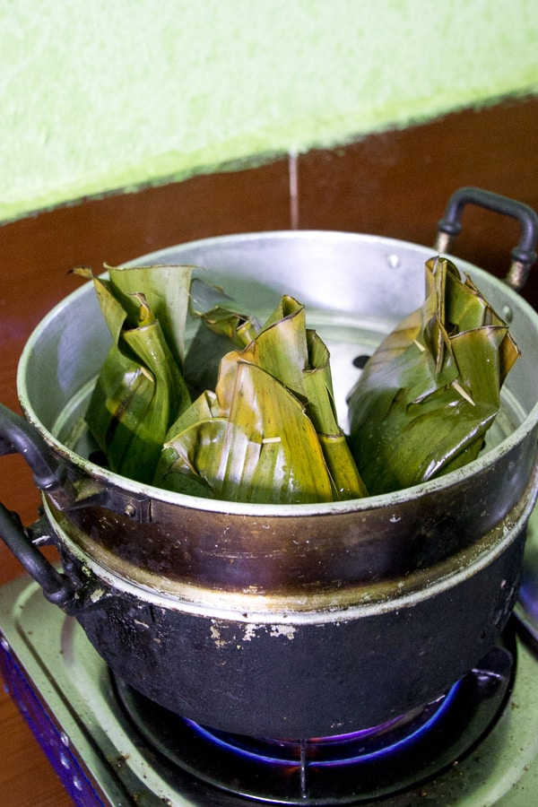 Lao Steamed Fish (Mok Pa) Recipe - Bursting from the banana leaf, these easy South East Asian flavour infused (hello, lemongrass!) steamed fish parcels are melt-in-your-mouth goodness. Gluten free. | wandercooks.com
