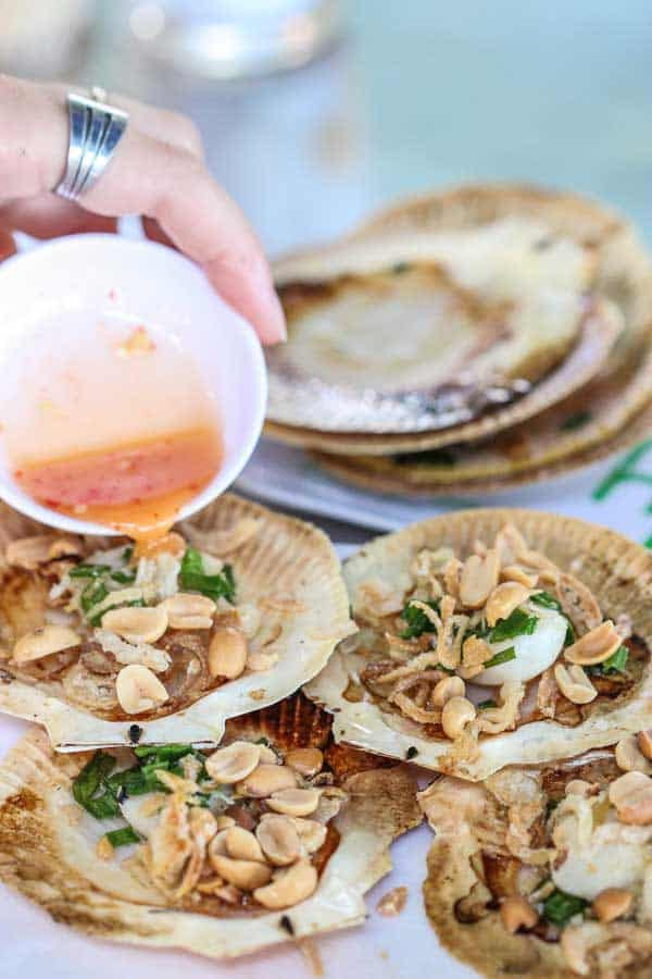 Vietnamese Grilled Scallops - For the perfect lunch by the beach, grill these bad boys up with some amazing spring onions and peanuts for the TASTIEST seafood you can imagine. | wandercooks.com