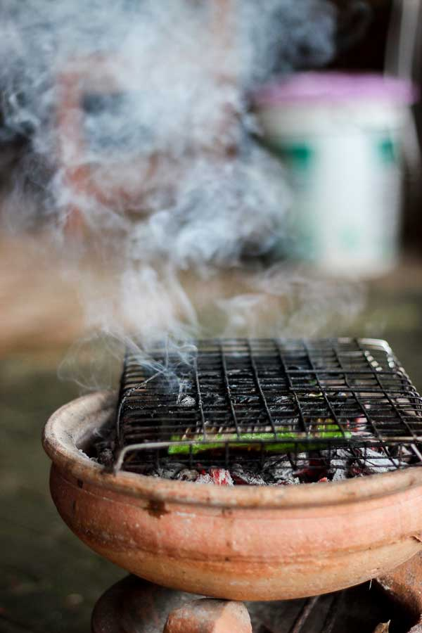 Flaming Charcoal Fish in Banana Leaves - A little bit sweet, a slight bit of salt and a lot of flaming charcoal goodness. Melt-in-your-mouth fish has never tasted so good. Pescatarian. | wandercooks.com