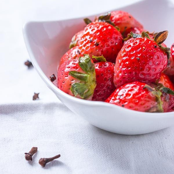 Honeyed Pepper Clove Strawberries - These sweet, healthy bites are a simple dessert that will be the topic of conversation at the dinner table. This flavour combination is SUPERB. Vegetarian.   wandercooks.com