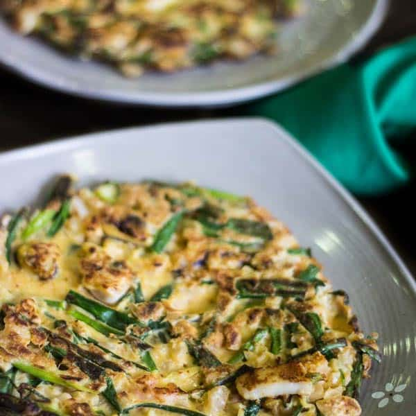 Crispy Korean Kimchi Seafood Pancake - Known as Haemul Pajeon, this is commonly found on the streets of South Korea. A quick, crispy and crunchy snack just waiting to be flipped onto your plate at home. | wandercooks.com