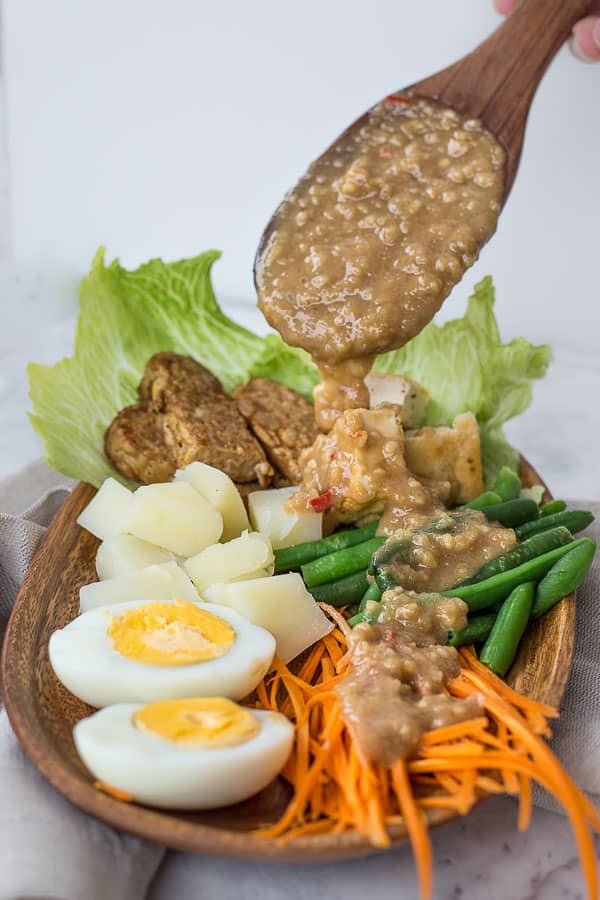 Indonesian Gado Gado Salad with Spicy Peanut Sauce - A tofu and veggie lover's delight. Found throughout Indonesia, this is an easy, homemade salad that is perfect for a main meal. | wandercooks.com