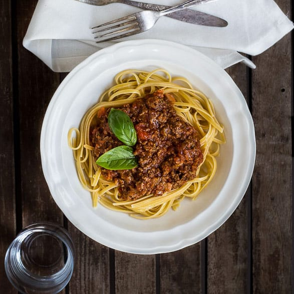 Smoky Beef and Bacon Bolognese - Holy smokes. We've kicked this pasta up a notch, with serious barbecue flavour for a bold dinner that even sneaks a secret vegetable or two. | wandercooks.com