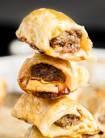 Stack of three bite size beef sausage rolls.