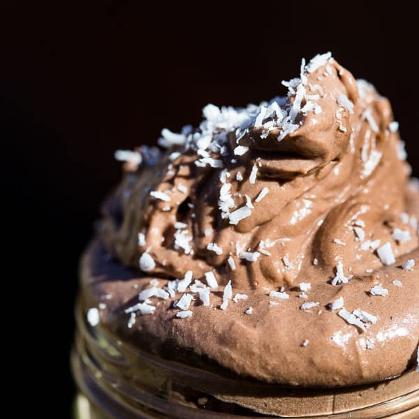Chocolate Mousse in a jar topped with coconut.