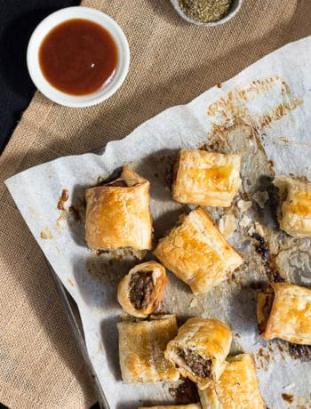 Easy Homemade Beef & Thyme Sausage Rolls - Born in Australia, the little crunchy Aussie bite-size snacks are perfect for lunch, dinner or a whole party! Serve with tomato sauce for extreme yumminess. | wandercooks.com