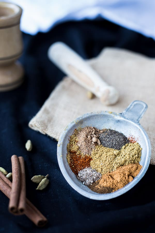 Baharat spices in a small silver dish, ready to be mixed.