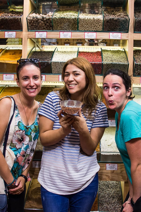 Sarah & Laura with a spice vendor in Istanbul's spice markets.