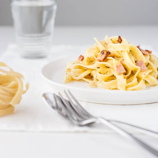 The Creamiest No Cream Carbonara Pasta - Your dinner dreams have come true. A gourmet meal ready in minutes with only a few ingredients. You've got this.   wandercooks.com