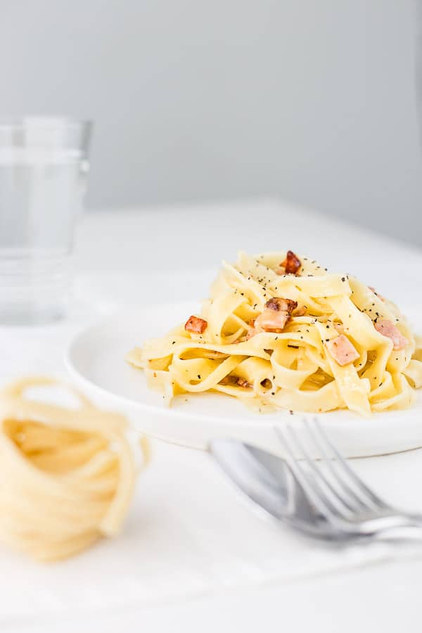 The Creamiest No Cream Carbonara Pasta - Your dinner dreams have come true. A gourmet meal ready in minutes with only a few ingredients. You've got this. | wandercooks.com