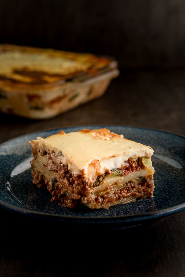 Easy Greek Moussaka Bake Recipe - Layers of baked eggplant, zucchini and fried potato and melted together with red-wine infused mince and topped with a bechamel golden cheesy crust. Need we say more? | wandercooks.com #moussaka #greek #bake #wandercooks