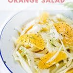 Bright bowl of fresh orange and fennel salad with pepper and olive oil.