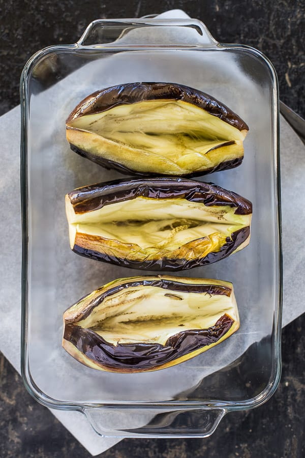 Sliced eggplants in a glass baking dish.