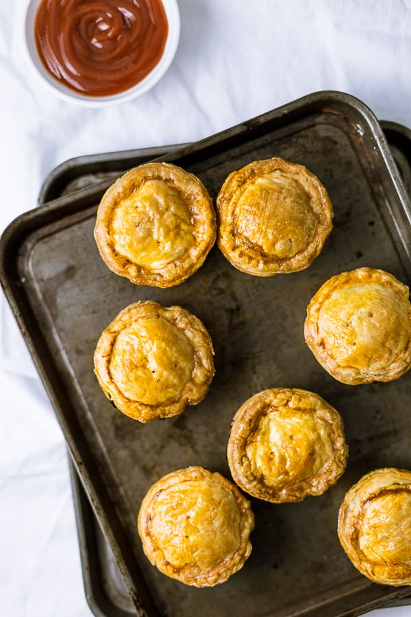 A tray of freshly baked party pies.