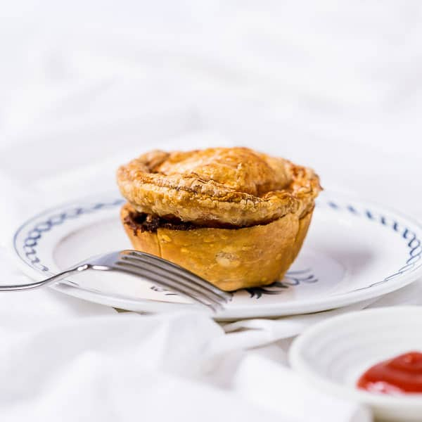 Australian Mini Meat Pies - Perfection in a crunchy bite, these little beef pies will win over your next party guests. So easy to make at home! | wandercooks.com