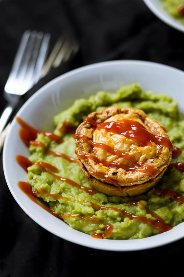 South Aussie Pie Floater - Creamy rich pea soup meets crunchy crisp beef pies. Topped with tomato sauce, and you have one delicious dinner combination. Too easy. | wandercooks.com