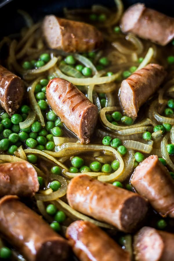 Best Ever Australian Curried Sausages Grilled Onion Slivers And Green Peas Smothered In
