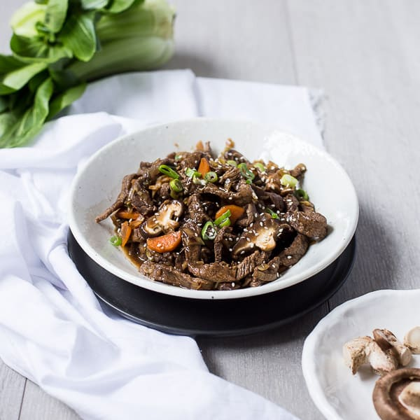 Bulgogi Korean BBQ Beef and Shiitake Mushroom - Thin tender slices of beef, marinated in an irresistible blend of soy, garlic, ginger, pear juice and sesame oil for a quick and easy mid-week dinner. | wandercooks.com