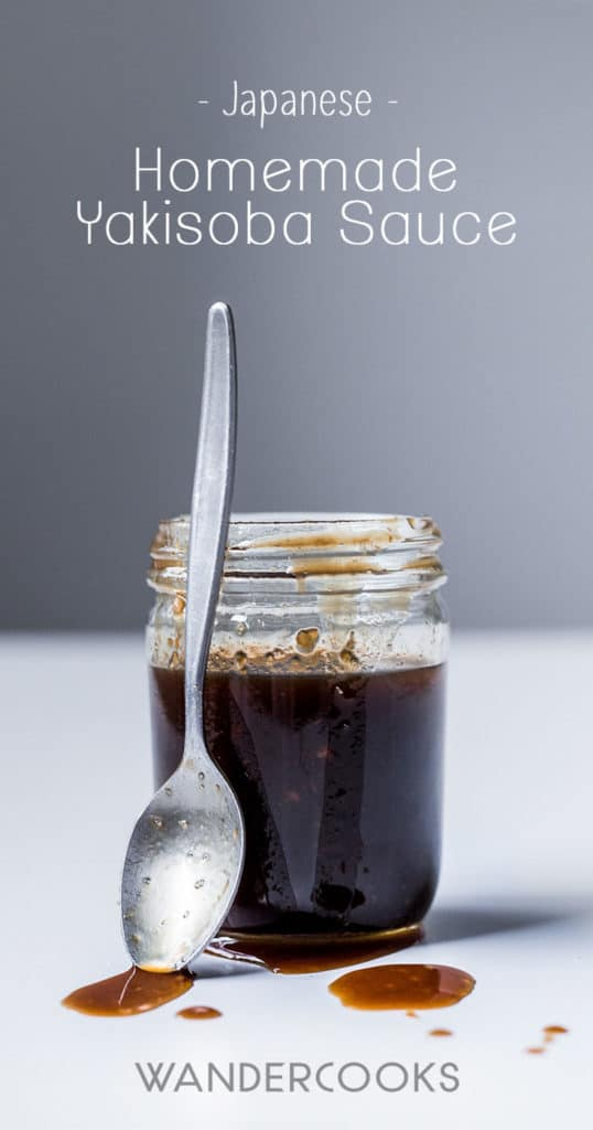 A glass jar of japanese barbecue sauce for yakisoba with a spoon next to it.