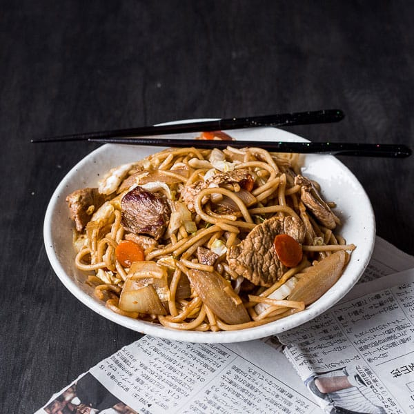 Yakisoba Noodles Recipe - A popular Japanese food street snack that's simple to make at home. Featuring pork and oodles of noodles.   wandercooks.com