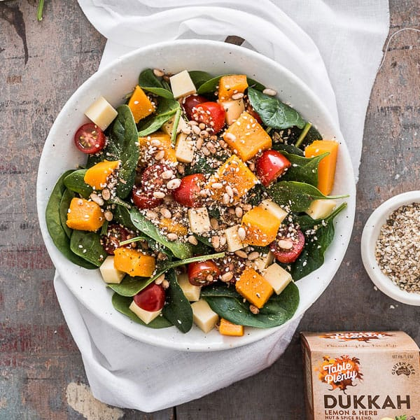 Pumpkin and Dukkah Salad - With a bed of spinach leaves, this salad just gets better as you top it with cheese, tomatoes, pine-nuts, pumpkin and dukkah. What a combo! It's the perfect side-dish or office lunch. Vegetarian. | wandercooks.com