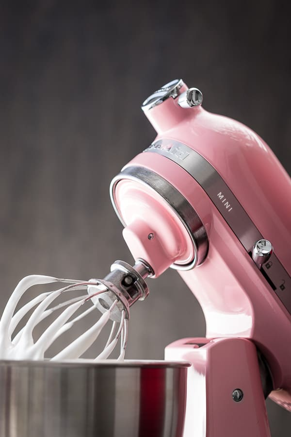 The KitchenAid mixer and whisk with meringue mixture.