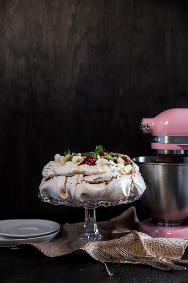 The finished pavlova on display beside a KitchenAid Mini Mixer.