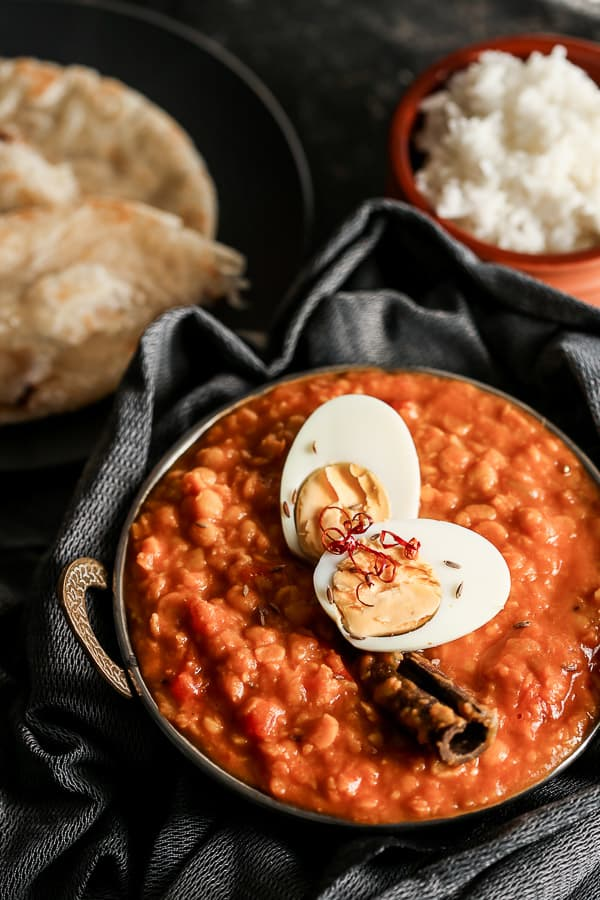 Yellow Moong Dal Curry with Egg - This creamy Indian dish is a vegetarian delight as a side or main meal. Perfect with rice and paratha - add a little chilli to top it off with some spice. | wandercooks.com