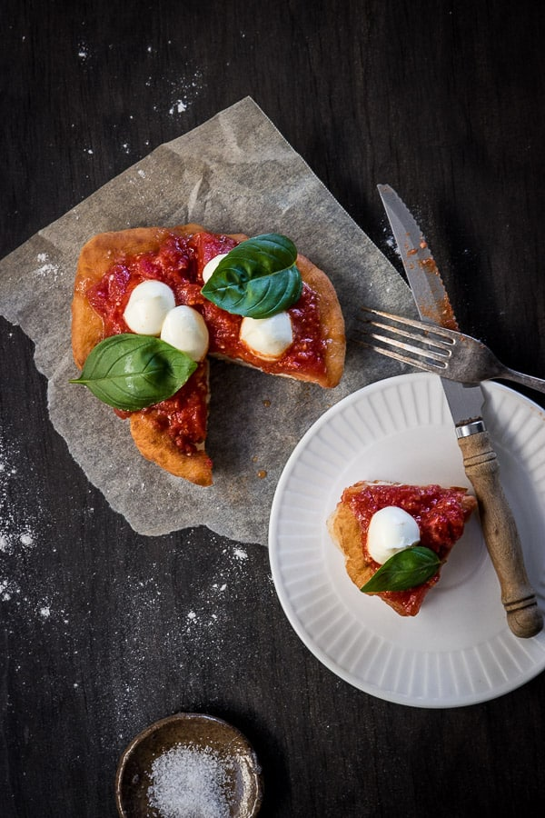 Italian Fried Pizza (Pizza Fritta Napoletana) - These' puffs of doughy goodness are just screaming to be made - in under 10 minutes! Top with tomato sauce, bocconcini and basil and it's ready to eat! | wandercooks.com