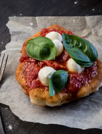 Italian Fried Pizza (Pizza Fritta Napoletana) - These' puffs of doughy goodness are just screaming to be made - in under 10 minutes! Top with tomato sauce, bocconcini and basil and it's ready to eat!   wandercooks.com