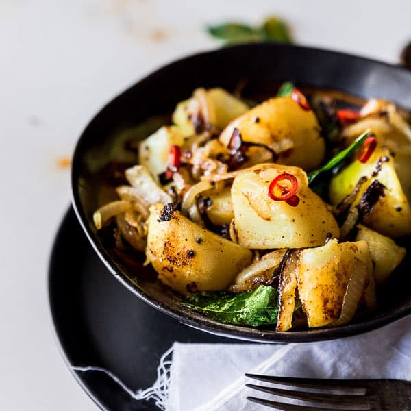 Deviled Potatoes Sri Lankan Style Recipe - Aromatic kestrel potatoes are boiled and fried with fragrant curry leaves, tumeric, chilli, mustard seeds and onion. | wandercooks.com