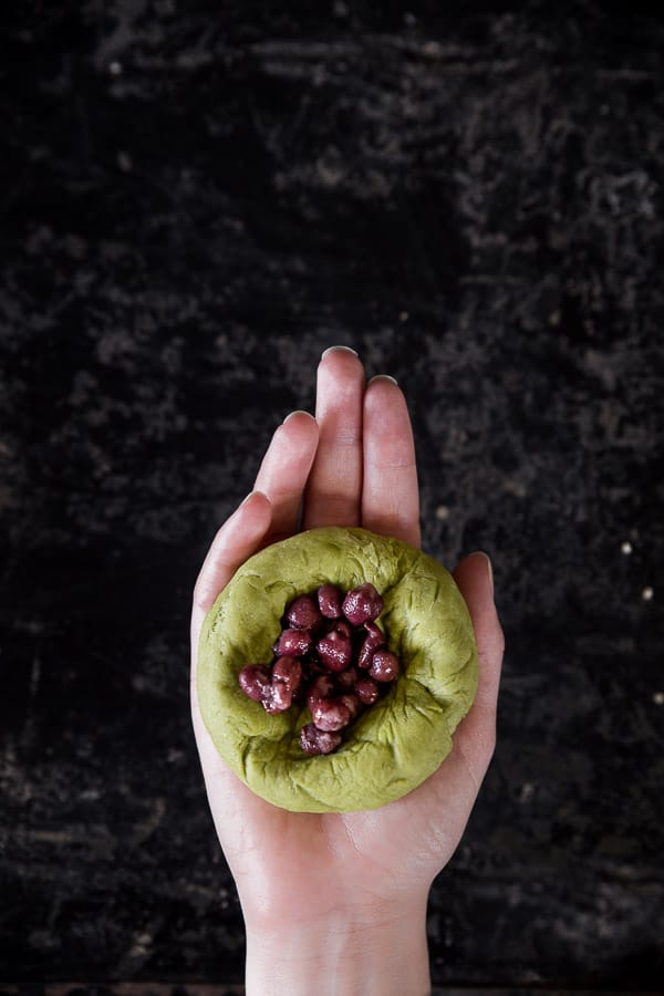 Matcha Hot Cross Buns Recipe - Easter is here, so why not try Japanese style Hot Cross Buns? Fluffy, slightly sweet with a touch of spice and azuki beans.   wandercooks.com