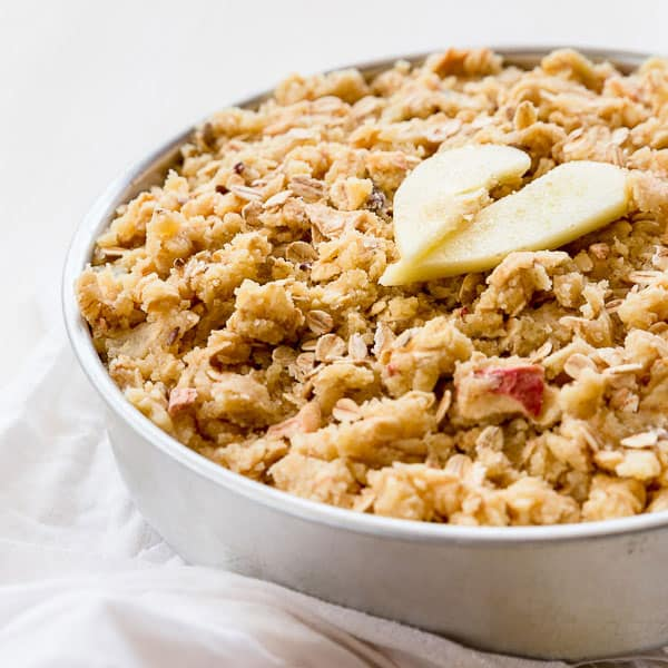 Basic Apple Crumble Recipe with Muesli - A crispy golden top layed over delectably sweet, soft apple. Top with cream or ice-cream for a wickedly good dessert. | wandercooks.com