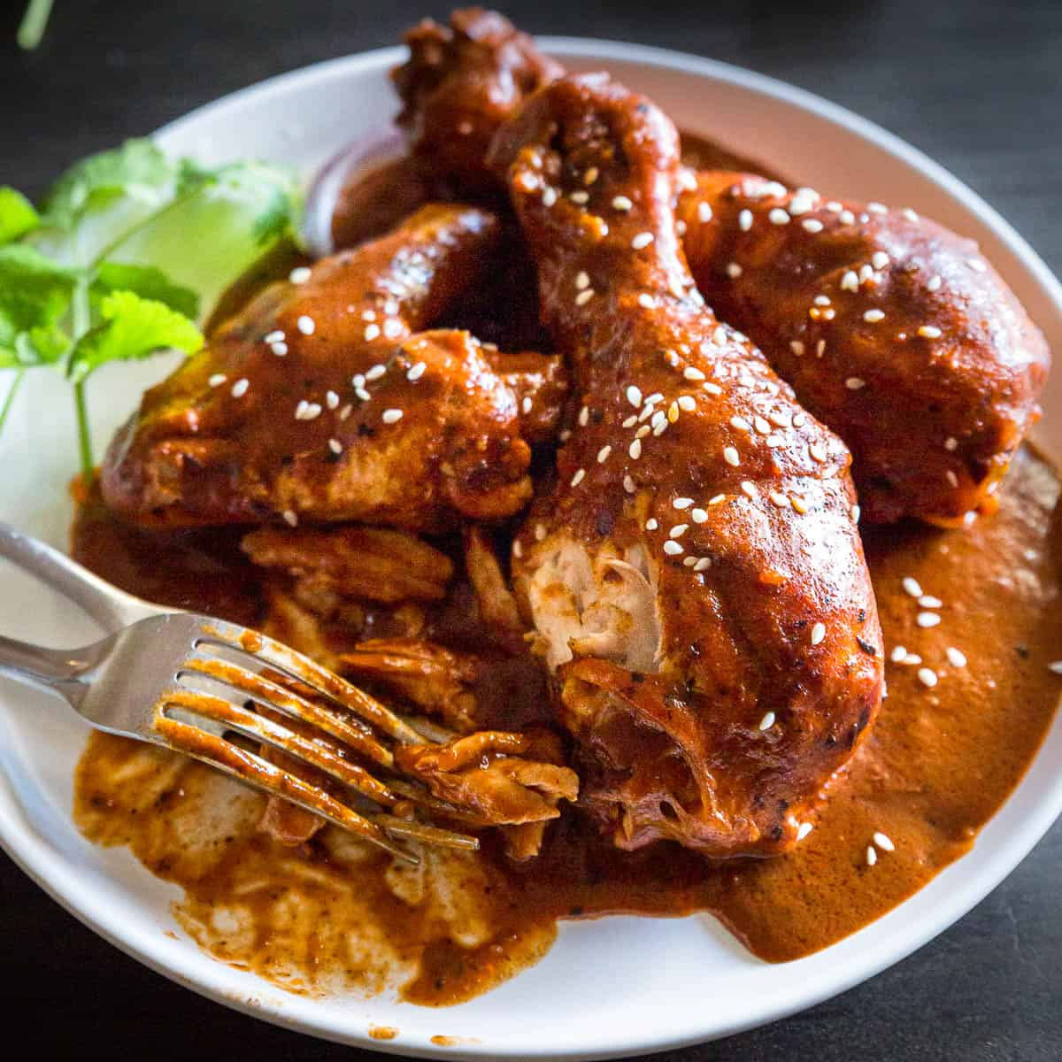 Warm brown chocolate mole sauce over chicken.