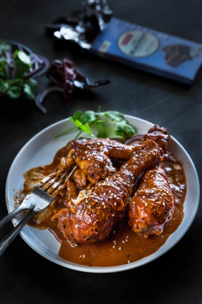 Chicken drumsticks cooked in rick Mexican chicken mole sauce.