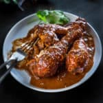 Mexican chicken mole on a plate with lashings of spicy chocolate sauce.