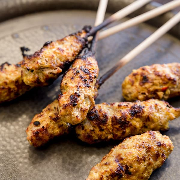 Sate Lilit - Balinese Minced Port Satays - These bite-sized Balinese morsels are going to change your life. Made with minced pork (or tuna or chicken), these easy Balinese Satays are packed with mouthwatering basa genap.