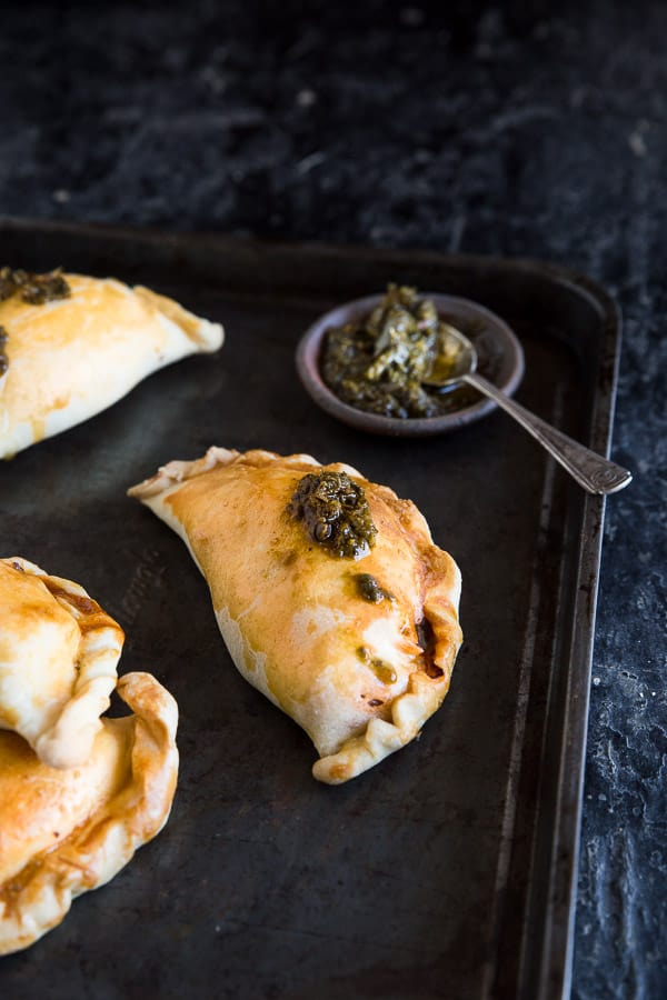 Chicken Empanada Recipe - Golden pockets of sweet and succulent chicken, perfect to share with friends for dinner. | wandercooks.com