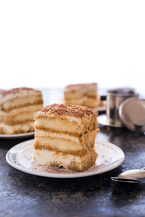 Simple Vietnamese Iced Coffee Tiramisu Recipe - A creative take on an Italian favourite, this simple tiramisu recipe is made with creamy, chocolatey Vietnamese Iced Coffee and sweetened condensed milk. Make ahead for a simple crowd-pleasing dessert - no bake, no fuss! | Wandercooks.com