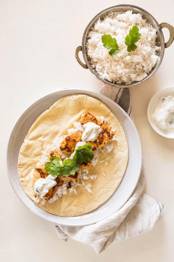 Tandoori Chicken Wraps Recipe - Succulent, tender tandoori chicken bites with rice, tzatziki, coriander in an easy, eat-on-the-go wrap. | wandercooks.com