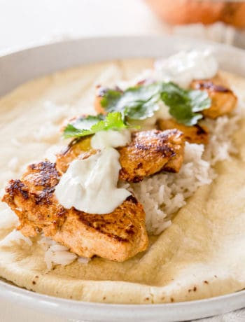 Tandoori Chicken Wraps Recipe - Succulent, tender tandoori chicken bites with rice, tzatziki, coriander in an easy, eat-on-the-go wrap. | wandercooks.com