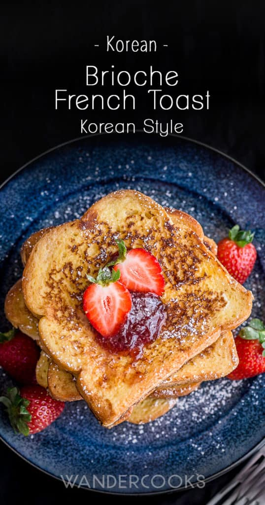 Brioche French Toast - Korean Style Recipe - Cooked in minutes, this sweet fluffy bread in a crispy egg coating is topped with lashings of strawberry jam and icing sugar for a deliciously indulgent breakfast. | wandercooks.com #brioche #frenchtoast #briochebread #breakfast #vegetarian #wandercooks